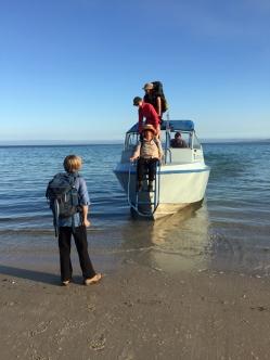 Disembarking at Bryans Beach